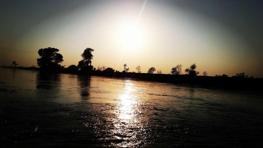 InPakistan SamsungJ7 Mobilephotography Mobile Click Sunset Sunset_collection Sun Water Reflections Water Reflection Riverside Beautiful Nature Eyeem Pakistan EyeEm Best Shots Pakistanphotochallenge