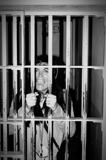 One Person Law Portrait Looking At Camera Real People Prison Indoors  Human Hand Architecture Black & White Long Goodbye EyeEmNewHere
