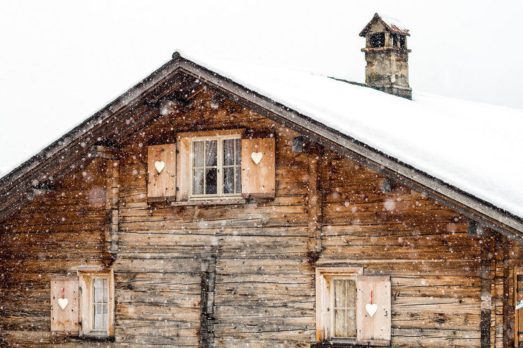 swiss challet in the snow Architecture Brown Day Freeride Hart Holiday Old Powder Skiing Snow Switzerland Weather Window Winter Wood