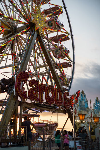 Amusement Park Amusement Park Ride Arts Culture And Entertainment Built Structure Cloud - Sky Day Enjoyment Excitement Fairground Ferris Wheel Fun Group Of People Leisure Activity Low Angle View Outdoors Sky Sunset Traveling Carnival