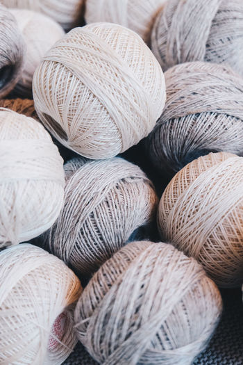 Textile Still Life No People Close-up Backgrounds Full Frame Large Group Of Objects Arrangement Abundance Wool Choice Variation Pattern Textured  Softness Indoors  Art And Craft Craft Ball Of Wool Group Of Objects Material Neutral Colors Yarn Yarn Balls Cotton Cotton Balls Strings