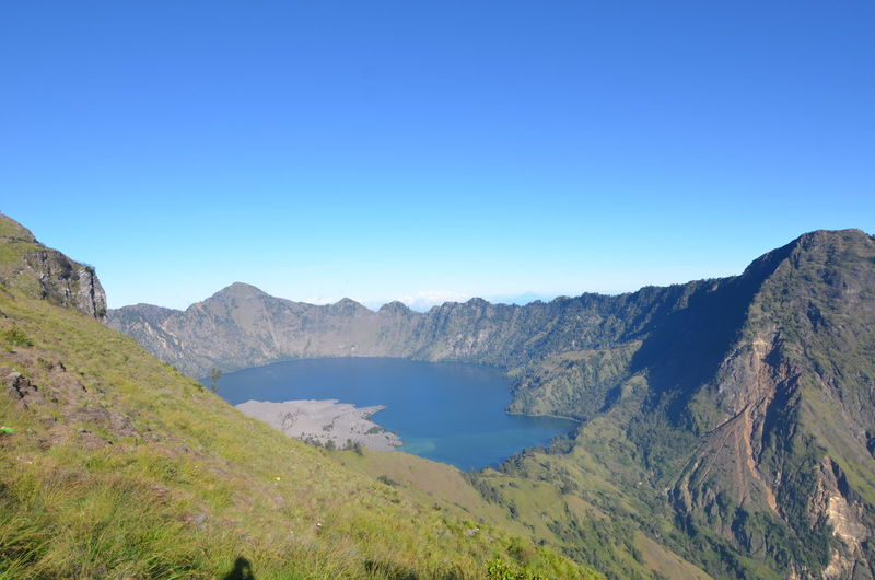 Rinjani Mountain, Lombok, Indonesia Agushariantophotography Beauty In Nature Blue Clear Sky Day Forest Idyllic Lake Landscape Mountain Mountain Range Nature No People Outdoors Pine Woodland Rinjani Mountain Scenics Segara Anak Lake Sky Tourism Tranquil Scene Travel Destinations Tree Vacations Water