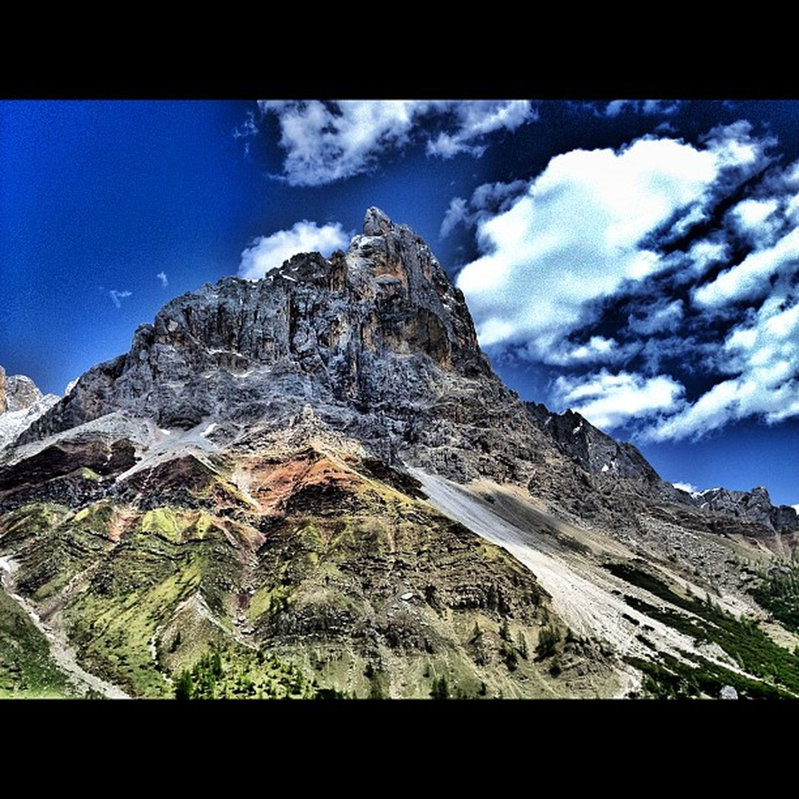 mountain, transfer print, sky, tranquil scene, tranquility, scenics, mountain range, beauty in nature, cloud - sky, auto post production filter, cloud, nature, landscape, blue, low angle view, non-urban scene, physical geography, idyllic, rocky mountains, majestic