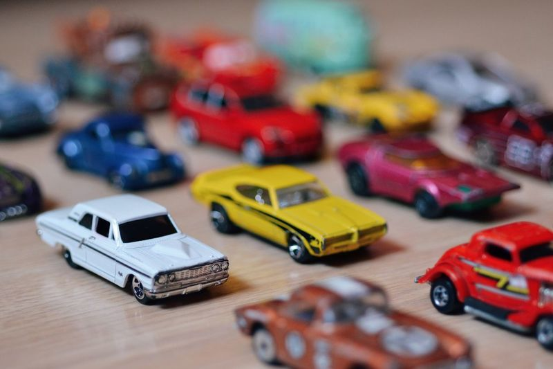 Close-up of various toy cars arranged on table