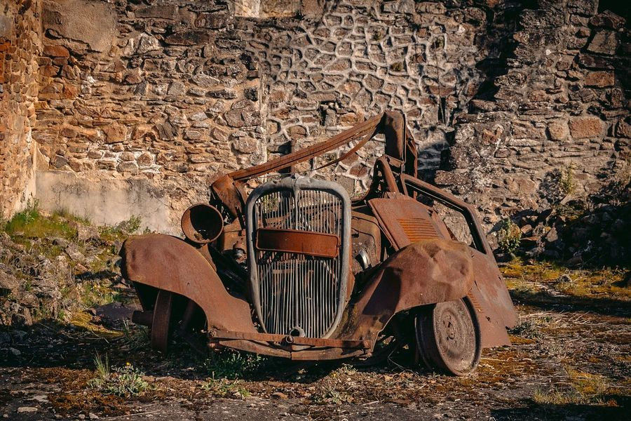 A rusty 1940's car in the destroyed village of Oradour sur Glane Vintage Cars Ww2 Rusty Rusty Autos Oradour S/ Glane Oradour Sur Glane Rusty Car Rusty Old Machine Decay 1940's Abandoned & Derelict Abbandoned