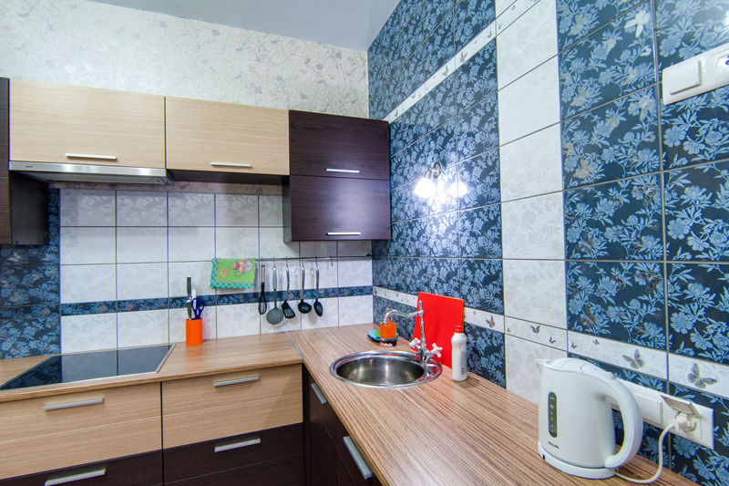 Domestic Room Indoors  Kitchen Home Household Equipment Home Interior No People Furniture Domestic Kitchen Flooring Kitchen Counter Modern Seat Architecture Table Lighting Equipment Wood - Material Wall - Building Feature Sink Chair Luxury Electric Lamp Clean