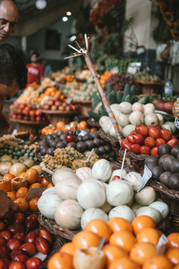 Funchal Madeira Abundance Business Choice Day Food Food And Drink For Sale Freshness Fruit Healthy Eating Incidental People Large Group Of Objects Market Market Stall One Person Real People Retail  Selective Focus Small Business Wellbeing