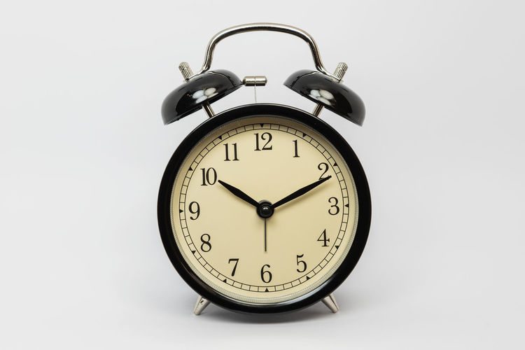Black vintage alarm clock on white background. Clock Time Alarm Clock Indoors  White Background Studio Shot Still Life Number No People Close-up Single Object Minute Hand Retro Styled Vintage Classic