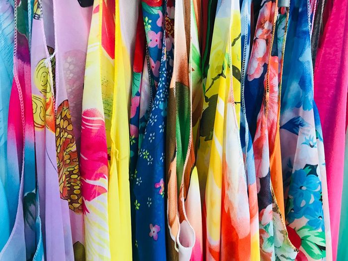 Multi colored scarves hanging in store for sale