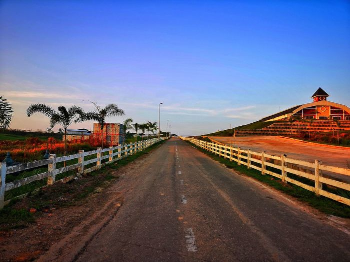 One fine morning at the farm Lsndscape Photographylovers Photography Blue Sky Sunrise_sunsets_aroundworld Morning Clear Sky Sky vanishing point Empty Road Leading Diminishing Perspective Country Road Straight Road White Line Dividing Line The Way Forward
