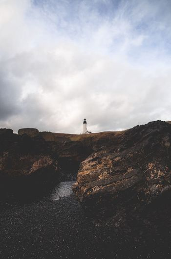 Lighthouse. Sky Nature Rock - Object Lighthouse Beauty In Nature Tranquil Scene Scenics Tranquility Outdoors Landscape Cloud - Sky Day Water Cliff Sea No People PNW PNWonderland Nw Lifeofadventure Optoutside Upperleftusa Takemoreadventures Northwest Nrthwst