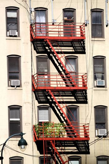 Light And Shadow No People Check This Out Red Balconies Conrast Street Photography Popular Photos EyeEm Gallery NYC Photography Popular NYC Street Photography Streetphotography Architecture_collection Red Symmetry Windows Fire Escape Steps And Staircases Staircase Steps Architecture Building Exterior Built Structure Emergency Exit Balcony