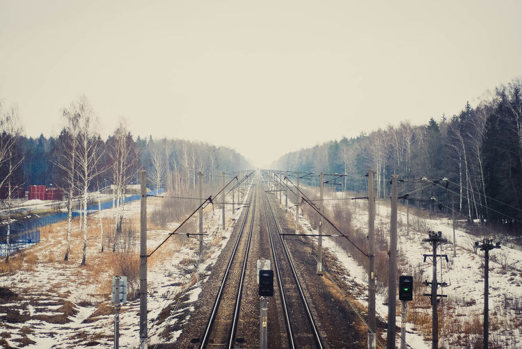 Panoramic view of railroad tracks against sky during winter