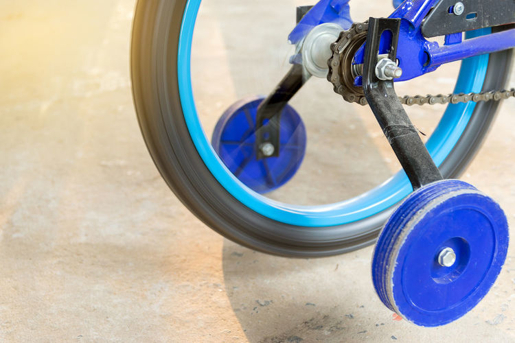 Close-up of bicycle wheel spinning outdoors