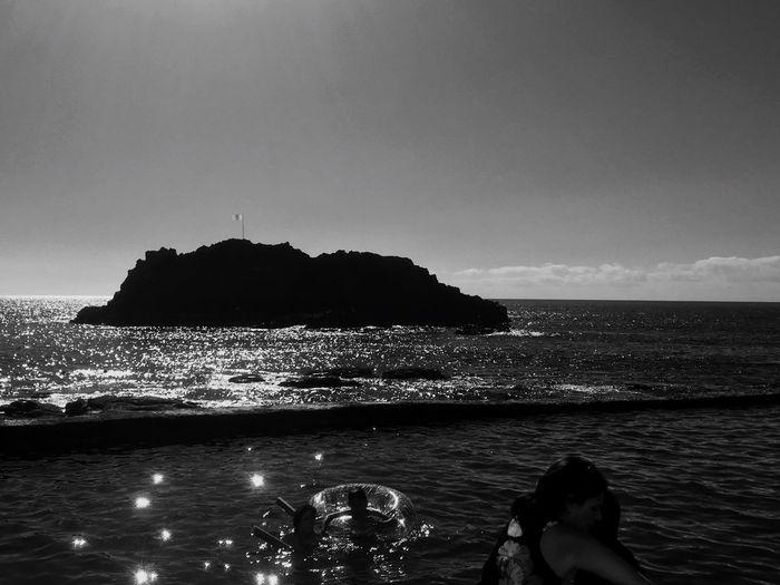 Blackandwhite Photography Blackandwhite Water Sea Sky Beauty In Nature Scenics - Nature Land Beach Silhouette Rock - Object Motion No People Tranquil Scene Tranquility Outdoors Rock Nature Horizon Over Water Horizon Idyllic