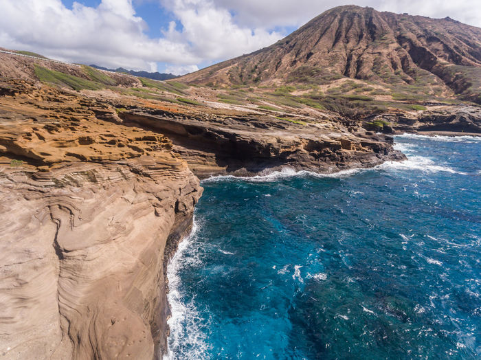 Aerial view of Koko Head crater and the Ocean, Oahu Hawaii Coastline Hawaii Oahu Rocky Rugged Travel Aerial View Beauty Beauty In Nature Crater Day Koko Head  Landscape Mountain Nature No People Ocean Outdoors Pacific Ocean Scenics Sea Sky Tourism Travel Destinations Water