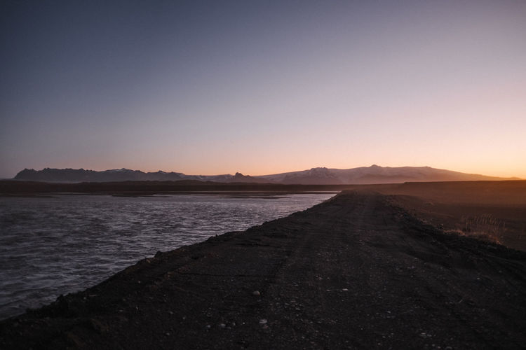 Sunrise by the Gigjukvísl River in East Iceland Sky Tranquil Scene Tranquility Scenics - Nature Beauty In Nature Mountain Water Sunset Nature Land Clear Sky No People Copy Space Non-urban Scene Environment Sea Landscape Idyllic Outdoors Arid Climate Gigjukvísl Iceland Gigjukvísl River
