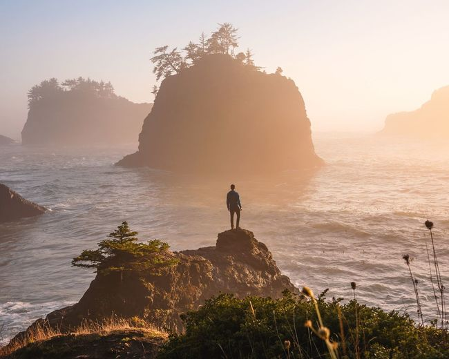 When it's been raining for days and suddenly the sky clears just in time for an epic sunset you don't take it for granted Pacific Northwest  Oregon Coast Oregon Rock - Object Sea Rock Formation Sunset Nature Beauty In Nature Standing Scenics One Person Water Silhouette Horizon Over Water Tranquility Cliff Full Length Wave Leisure Activity Real People Adventure Men