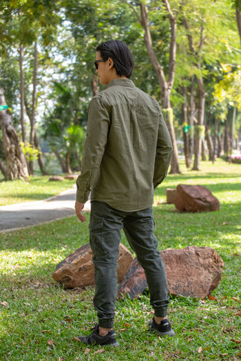Rear view of young man standing in park