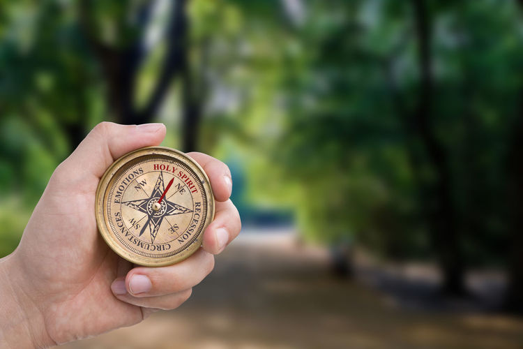 Male Hand Holding Compass - Holy Spirit Male Hand Fingers Holding Compass Direction Christianity Religion Faith Navigation Lost Guidance Counsel Path Forest Trees Followme Wisdom Green Crossroads Route Way Preparation  Nature Inspire Holy Spirit Spirit Led