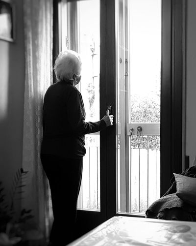 Senior Woman Standing By Door At Home