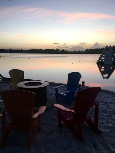 Beach Time Orlando Water Reflections Beach Beauty In Nature Chair Chairs Evening Lake Nature No People Outdoors Scenics Sea Sunset Table Tranquility Water Perspectives On Nature