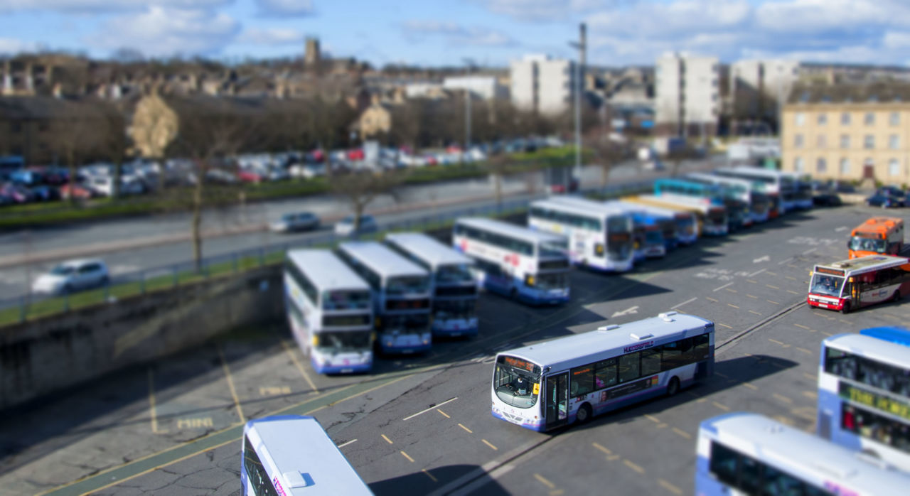 car, land vehicle, transportation, high angle view, mode of transport, road, street, tilt-shift, day, no people, outdoors, city, toy car, building exterior