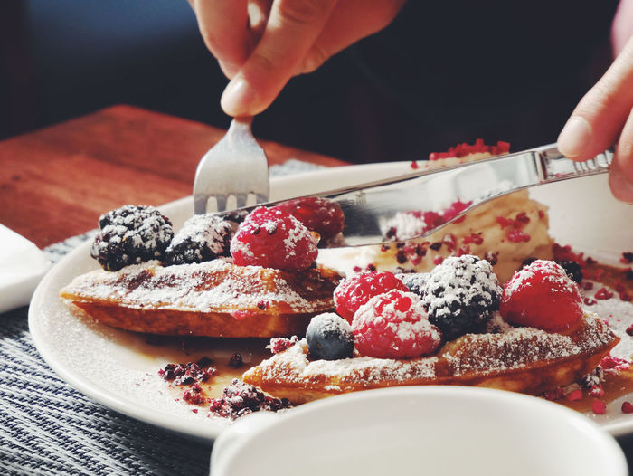 Waffle Close-up Day Dessert Food Food And Drink Freshness Fruit Holding Human Body Part Human Hand Indoors  Indulgence One Person People Plate Ready-to-eat Real People Sweet Food Table Temptation Unhealthy Eating