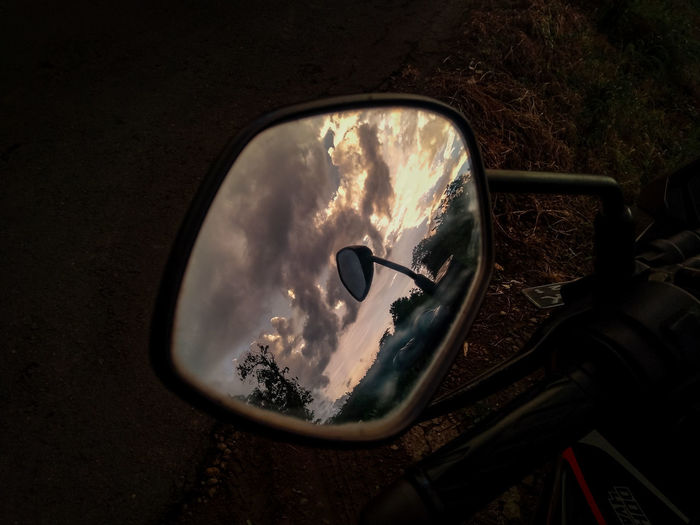 High angle view of reflection of car on side-view mirror