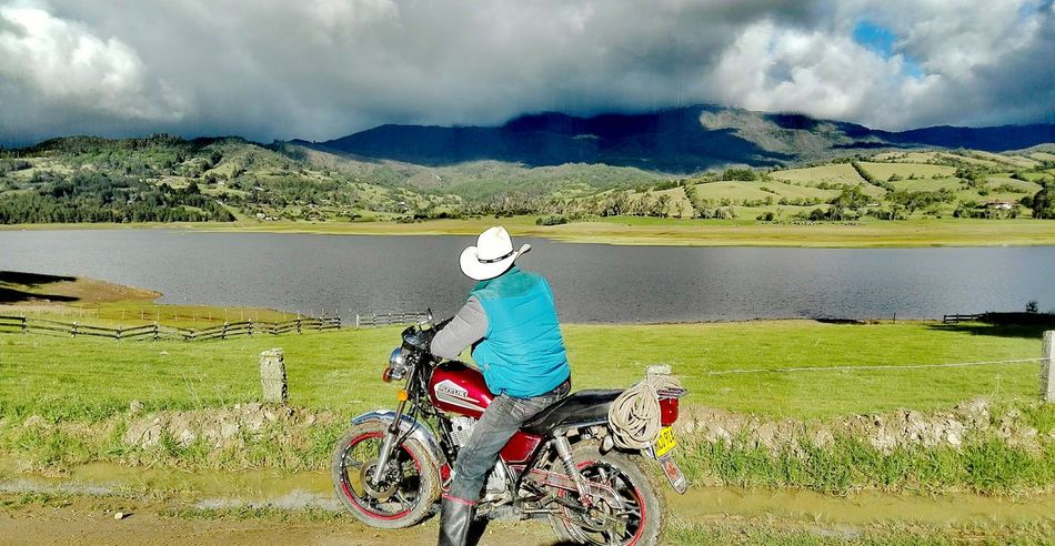 Embalse del Sisga, Colombia Bicycle Cloud - Sky Lake Outdoors One Person Nature Water Day Leisure Activity Sky People One Man Only Scenics Shadow Adult Only Men Mountain Headwear Lakeside Colombia Tradition Cowboy Travel Destinations EyeEmNewHere Beauty In Nature