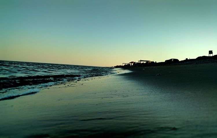 Water Sea Beach Clear Sky Tranquil Scene Scenics Copy Space Tranquility Horizon Over Water Beauty In Nature Sand Sunset Calm Nature Shore Non-urban Scene Blue Waterfront Outdoors Sky No People Wide