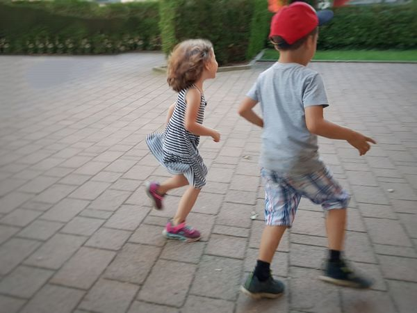 Full Length Childhood Togetherness Bonding Child Playing Females Summer Girls Rear View Sibling Sister Brother