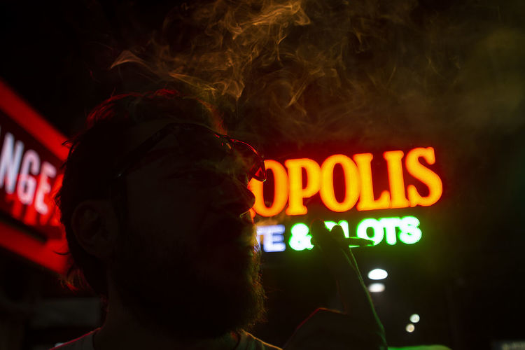 nightlife HUAWEI Photo Award: After Dark Adult Communication Headshot Illuminated Lifestyles Men Neon Night Nightlife Portrait Real People Western Script