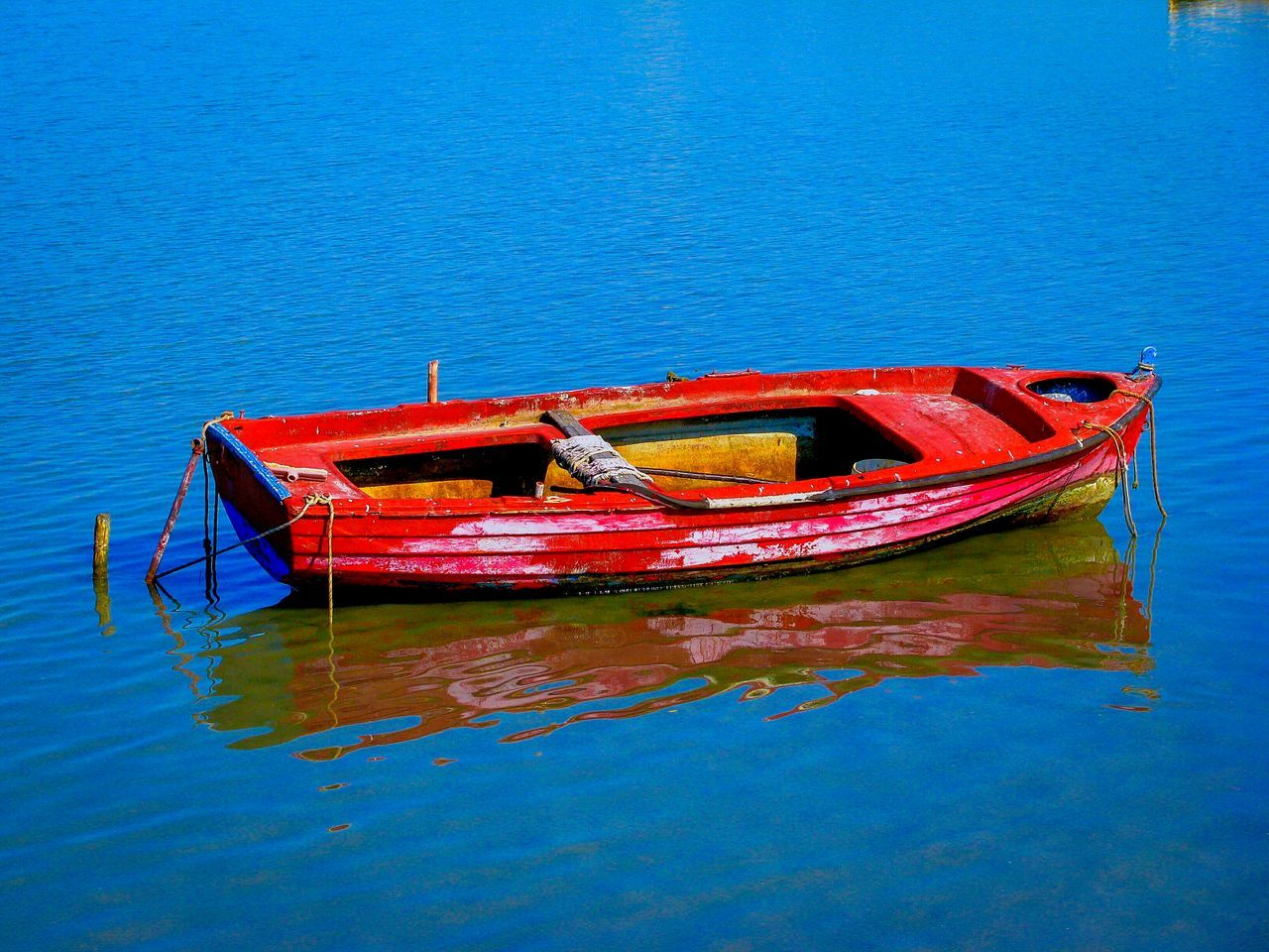 Red Boat Moored Over Lake