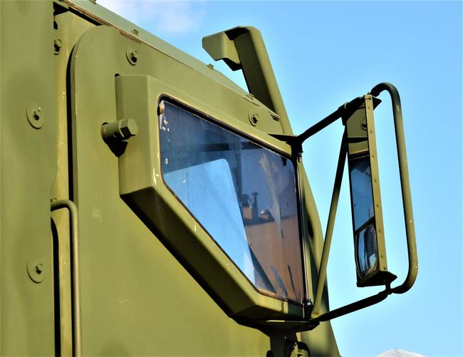 United States Military Vehicle Window Mirror United States Military Clear Sky Close-up Day Focus On Foreground Land Vehicle Low Angle View Machinery Metal Military Military Truck Military Vehicle Military Vehicles Mode Of Transportation No People Outdoors Side Mirror Sky Sunlight Transportation Truck Truck Window Window