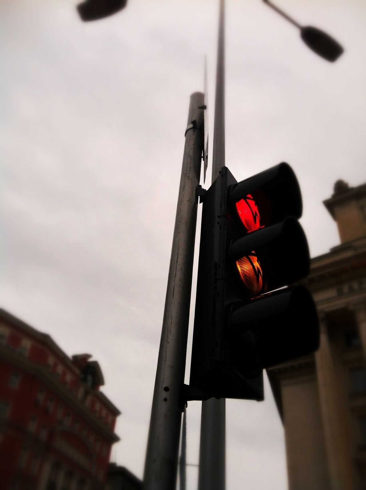 Low angle view of traffic light against sky