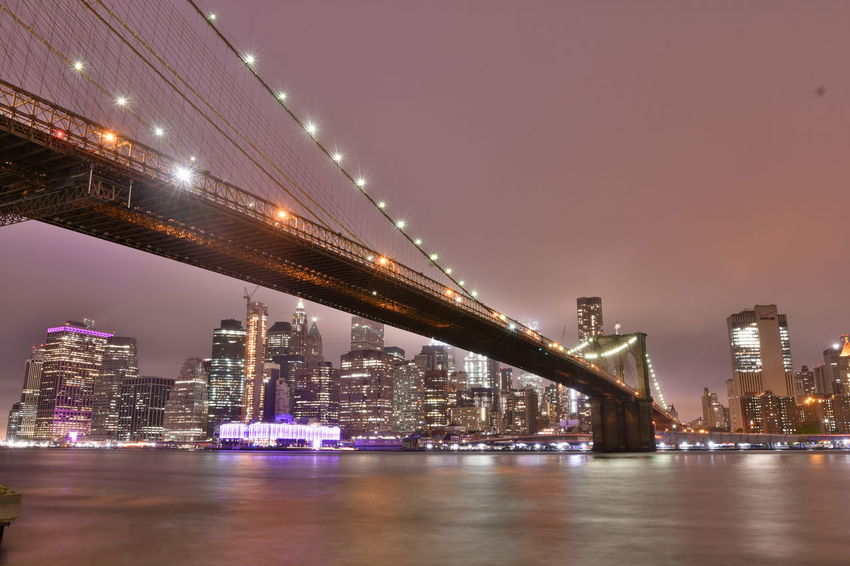 New York Brooklyn Bridge / New York New York New York City Architecture Bridge Bridge - Man Made Structure Building Exterior Built Structure Bulb City Cityscape Connection Engineering Illuminated Nature Night Office Building Exterior Outdoors River Sky Skyscraper Transportation Travel Destinations Water Waterfront