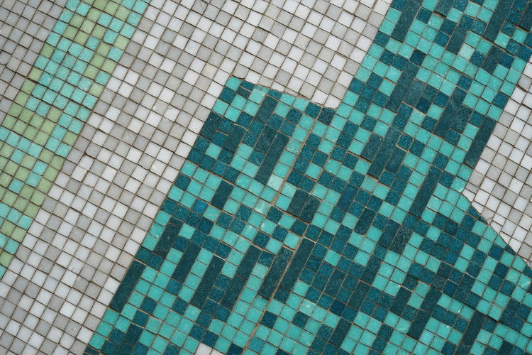 Full frame shot of tiled floor by swimming pool