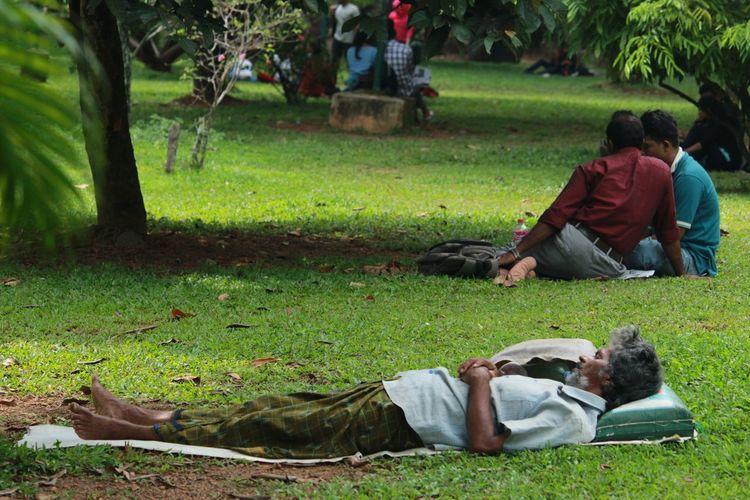 Full length of man relaxing in park