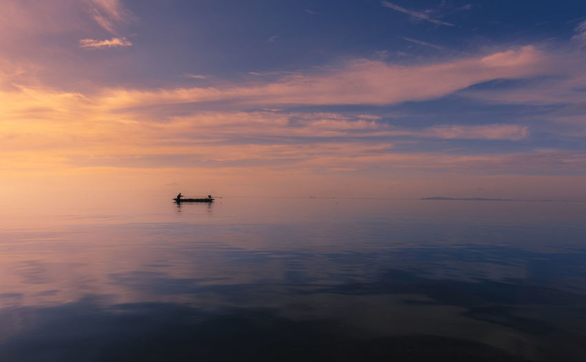 Beauty In Nature Cloud - Sky Horizon Horizon Over Water Idyllic Mode Of Transportation Nature Nautical Vessel No People Orange Color Outdoors Reflection Scenics - Nature Sea Sky Sunset Tranquil Scene Tranquility Transportation Water Waterfront