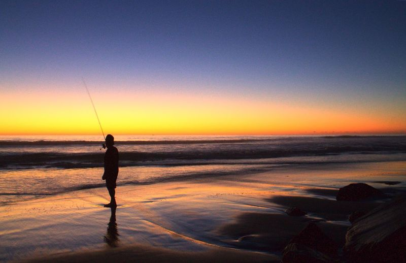 Showcase July Sunset Silhouettes Sunset Golden Horizon Beach Life Fishing Sand Sand And Sea Land Seas And Skies Landscape Colorful Reflections Reflections On The Sand Smooth Texture Milky Water Trail Smooth Waves Smooth Reflections Colors Colors Of Sunset Colour Of Life California Dreamin