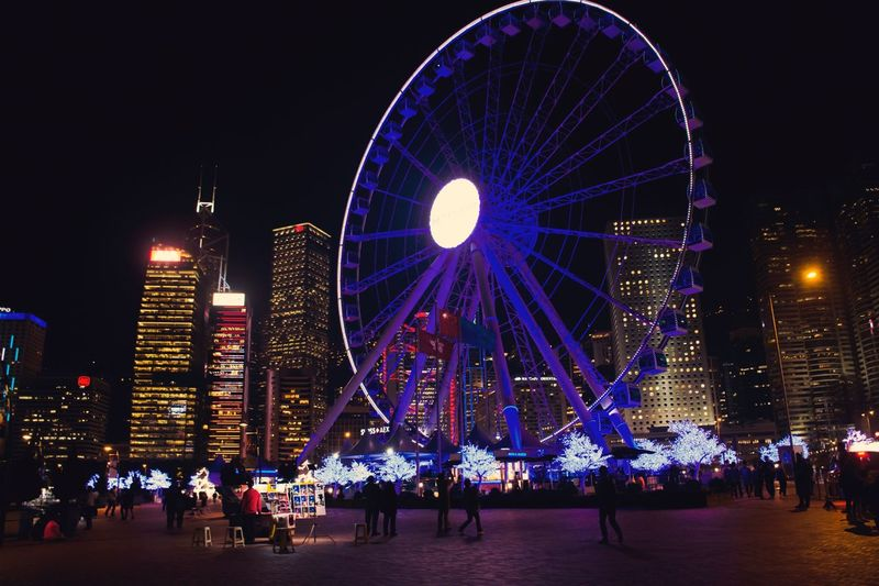 Night Illuminated Ferris Wheel Building Exterior Built Structure Large Group Of People Architecture Arts Culture And Entertainment Outdoors Sky City People