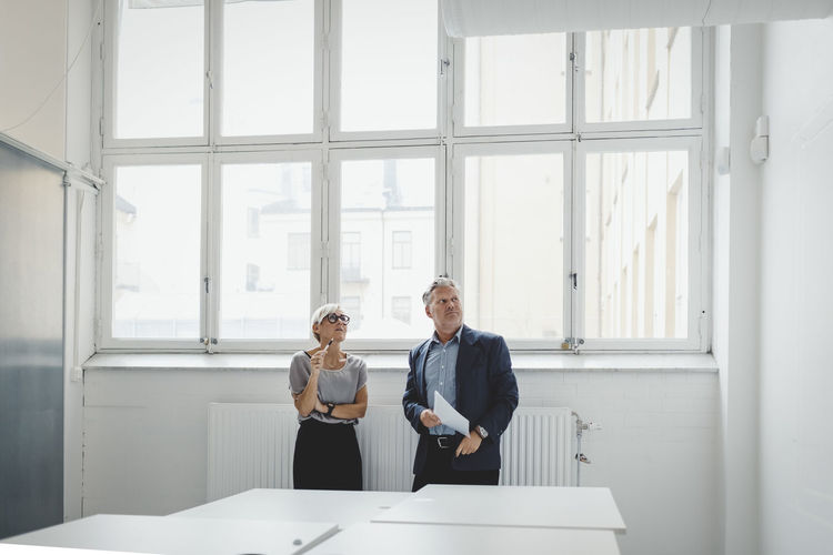 Man and woman on table by window