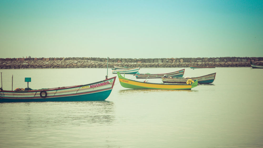 Boats. Sunsets. Beautiful Beauty In Nature Boats Calm Calmness Clouds And Sky Fishing Fishing Boat Fishing Time Fishing Village Harbor Harbour Harbour View India Kerala Life Style Peaceful Skyline Sony India Sonyalpha Summer Sunset Tranquil Scene Tranquility Travel Photography