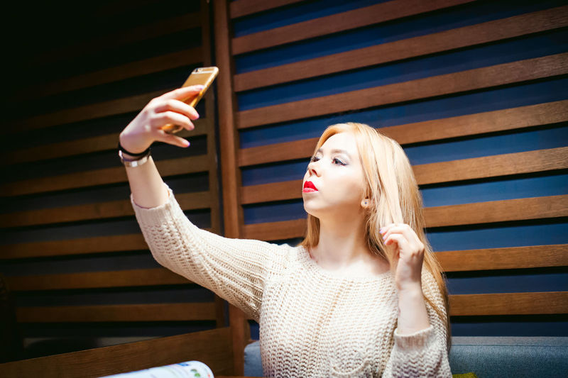 Close-up of woman taking selfie through mobile phone