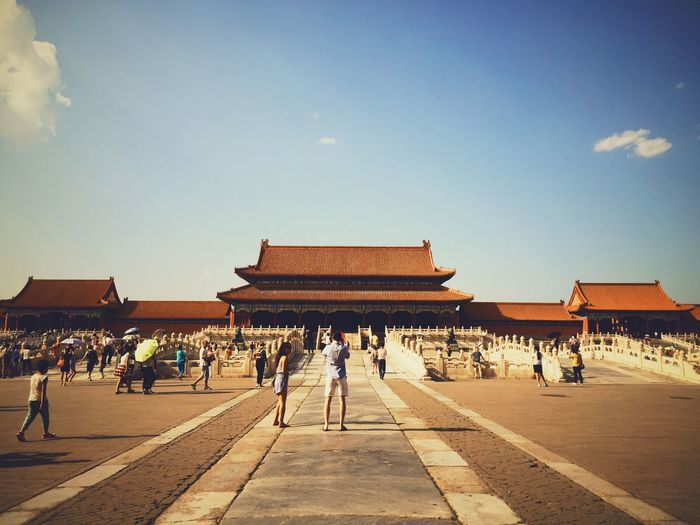 People At Forbidden City Palace Against Sky