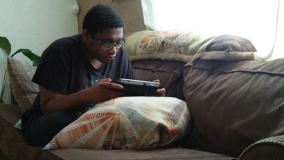 Jackson Michigan Couch Potatoing Sitting On The Couch Enjoying Life Boy With Glasses Boy Playing Video Games Video Gaming Enjoy The New Normal The Portraitist - 2017 EyeEm Awards