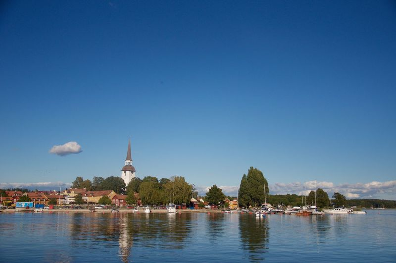 Village By Lake Malaren Against Blue Sky