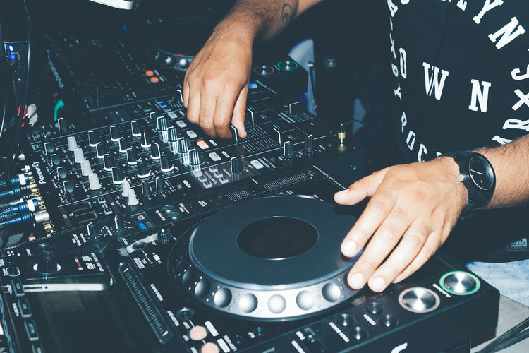 Club Dj Control Dj Human Body Part Human Hand Mixing Music Nightclub One Person People Sound Mixer Sound Recording Equipment Technology Close Up Technology