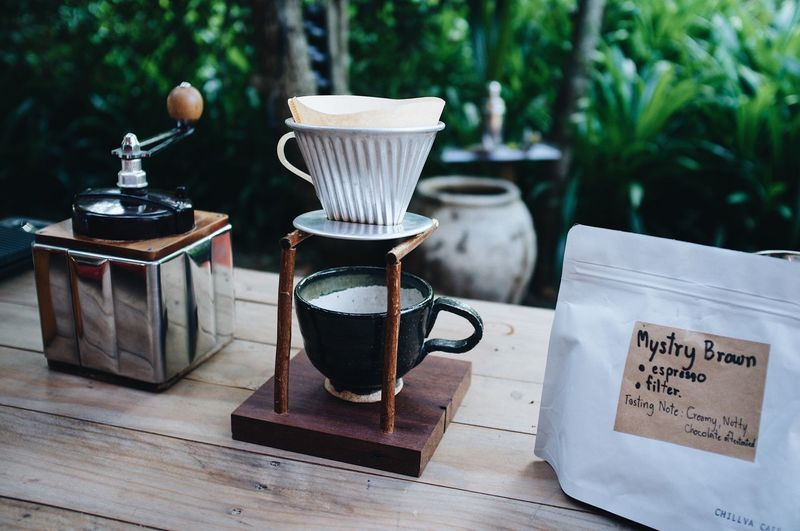Blackcoffee Coffee Craft Coffee Drip EyeEm Selects Text Table Day Western Script No People Focus On Foreground Coffee - Drink Coffee Wood - Material Plant Outdoors